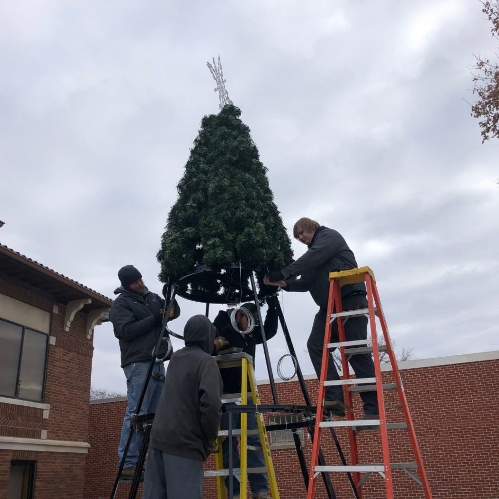 C & B Sibley got the entire Sibley community into the Christmas spirit by installing light up snow flake decorations on the light poles downtown and constructing the city's new artificial Christmas tree.